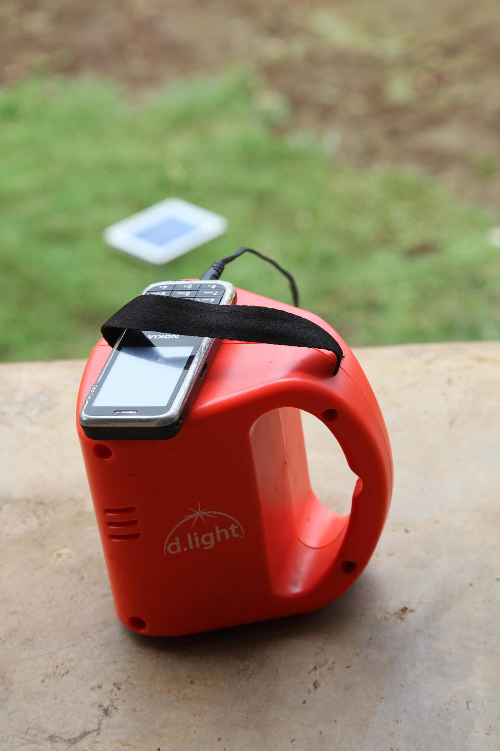 Solar lamp with a phone charger