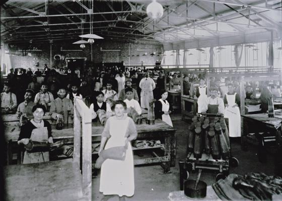 Assembly line workers are making rubber boots in Hutchinson factory near Montargis in France (1910)