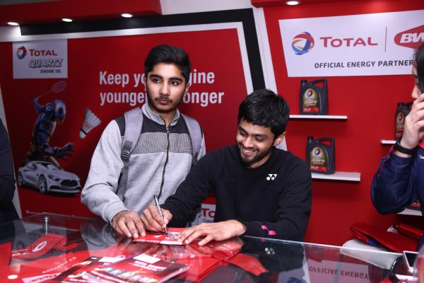 Indian badminton player Sai Praneeth at our Total stall at BWF India open 2018.